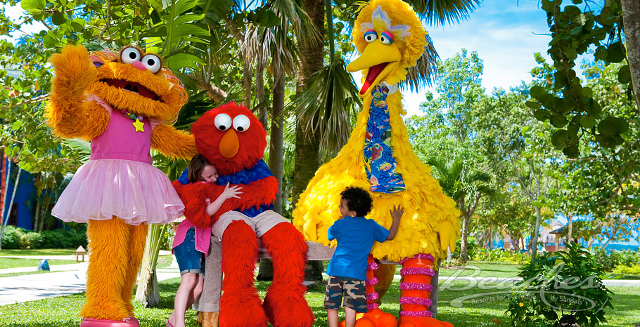 Big Bird and Elmo with family